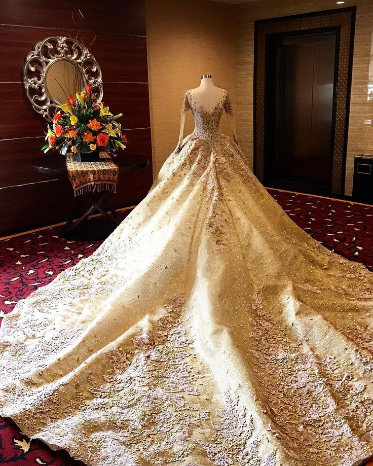 Happy Wedding for Yhayha and Husein...  ❤️❤️❤️  .  Our gorgeous bride is wearing fairytale Gold Champagne Wedding Ball Gown embed with nude pink colour beads.  .  #meltatan #brides #bride #brideoftheday #ballgown #gold  #touch #mix #champagne #skincolour #crystals #lace #swarovski #detail #glittery #fabric #all #shiny #design #look #venue #lombok #mataram #ntb #indonesia #currentview