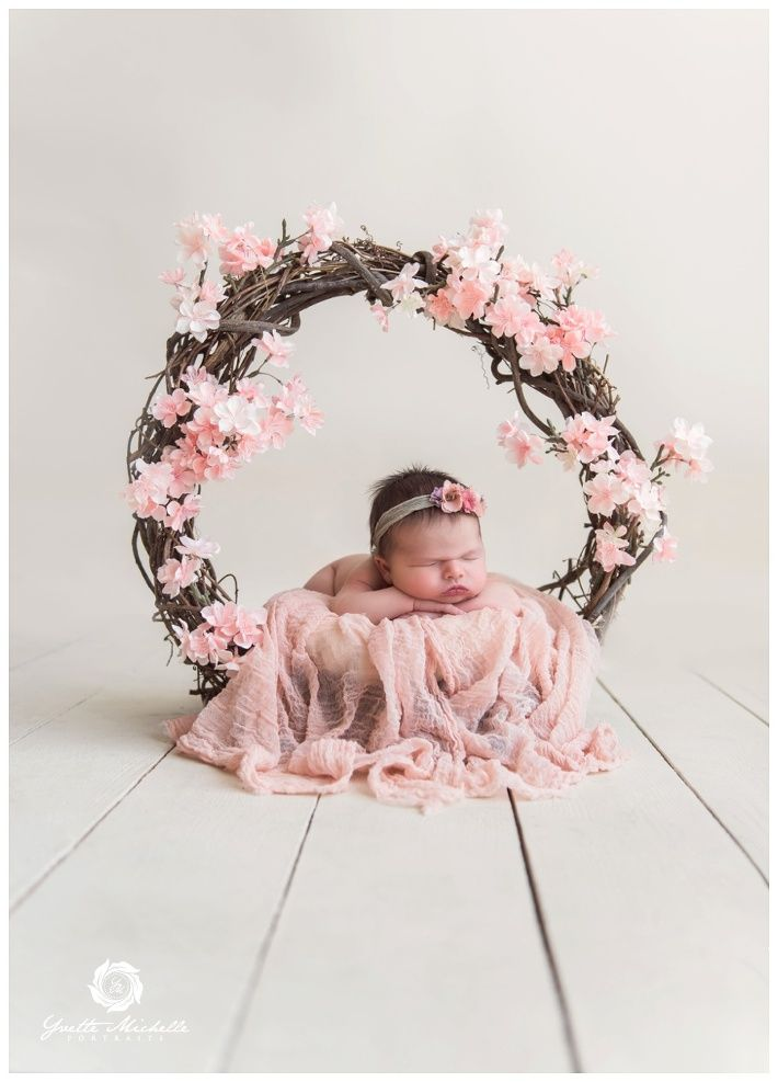 Beautiful newborn photography props really draw the eye towards the baby here