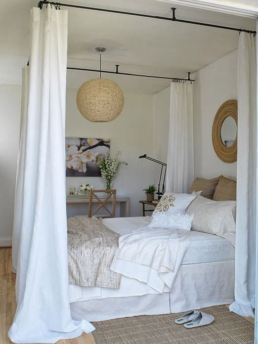 Great idea.  DIY canopy bed, hang drapery rods from ceiling and can even sew your own drapes.  I probably would have raised the bed a little more, though before skirting it. (Would also give you more room for storage under bed.)  You can buy bed lifters at places like Target.