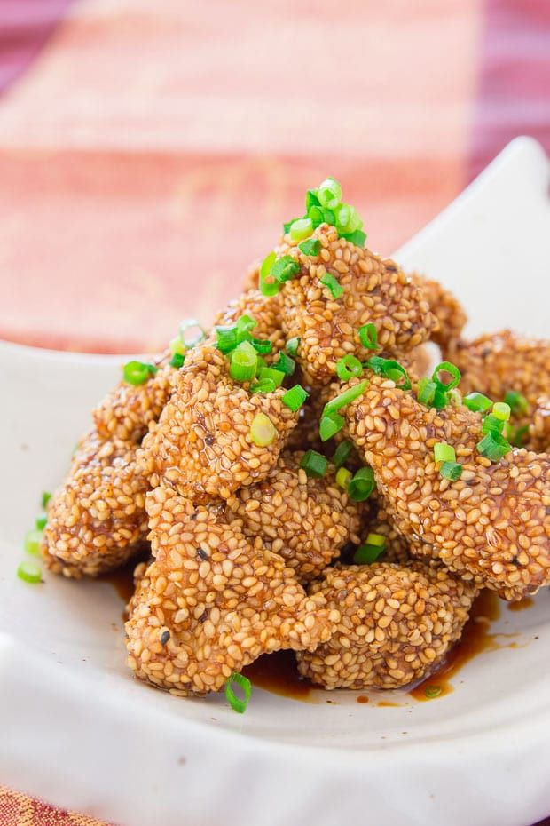 Tender morsels of chicken coated in earthy sesame seeds and lacquered with a sweet and savory glaze, this recipe makes the best sesame chicken.