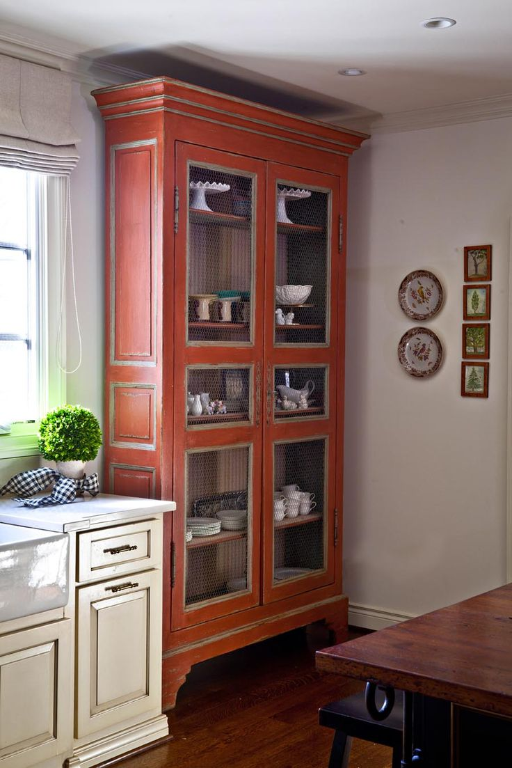 Design Tip from Nell Hill's - Add large, free-standing cabinets to the kitchen floor plan. While your built-in cabinets will hold the lion share of your everyday kitchen items, from food and spices to dishes and pans, it's really fun to bring in a contrasting cabinet to use for more eye-catching kitchen items, like pretty soup tureens, platters and pitchers.