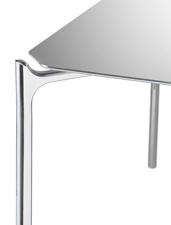 Extremely thin, and extremely sturdy table - a simple and elegant design without sacrificing safety or functionality.
