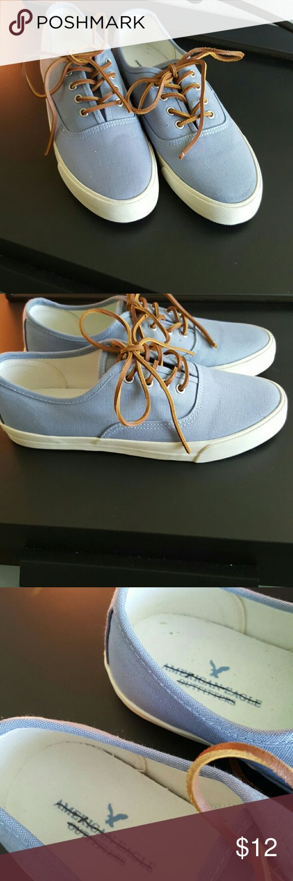 American Eagle Outfitters womens fashion sneakers Light blue fashion sneakers with faux leather laces. Name is scratched through since I bought from an outlet store. American Eagle Outfitters Shoes