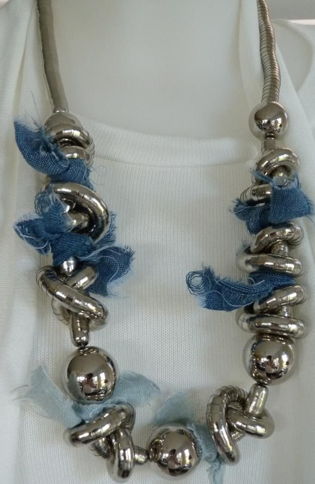 Chunky silver with intertwined blue fabric, ideal over a white top