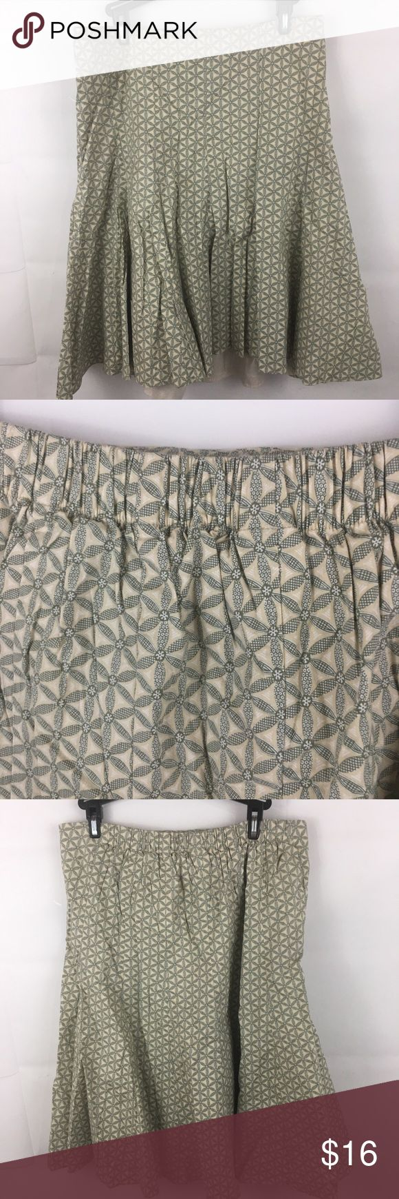 Gap Maternity Trumpet Skirt Size 10 Green Floral Gap maternity skirt size 10  trumpet style skirt, lined, green and white floral  good pre-owned condition.  No holes or stains. Initials on inside tag.  stretch waist with elastic back  22 inch length GAP Skirts