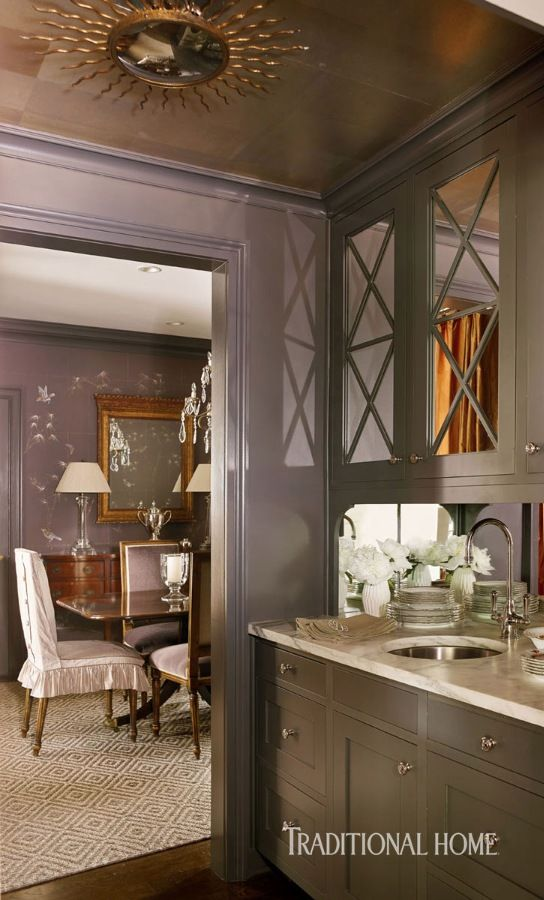 Mirrored cabinets in the butler's pantry mimic the doors in the adjacent dining room. Countertops are richly veined Calacatta marble. - Photo: Emily Jenkins Followill / Design: Courtney Giles