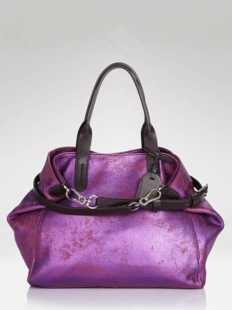 If mom must carry everything but the kitchen sink, it might as well be in something as stunning as this metallic purple tote. #momuniform