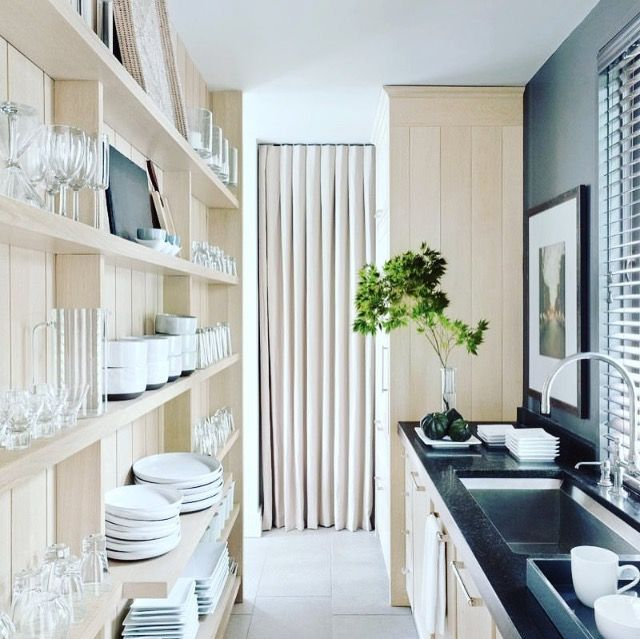 A narrow kitchen is an opportunity! Slim shelves are perfect for spices, glasses, and small plates that would get lost in deep cabinets. Silver lining! ⛅️☀️image via @archdigest