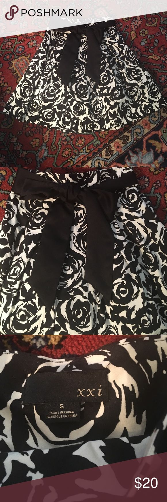 Black and white skirt size S Black and white skirt Size S by XXI. Worn a few times and in excellent condition. Includes black bow. Zips up the side. Skirt measures 20 1/2 inches from waist to hem. Skirt has cute pleats that make it poof out and it is lined. XXI Skirts Mini