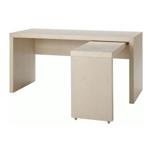 Ikea craft table with pull out panel, could be spiffed for craft space.  Good space saver.
