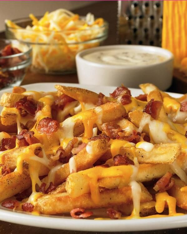 Bacon crumbled cheese fries...to go with a Crock Pot full of hot dogs plus some raw veggies and dip...have to wrap them up good in food and get the kids eating right away though!