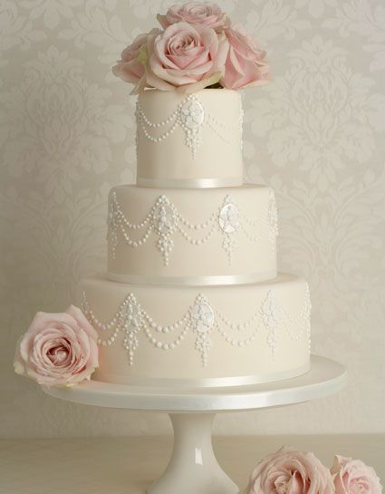 white cake pink flowers