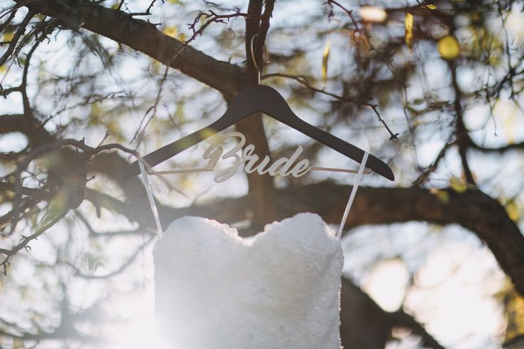 Wedding Photography in Windsor Ontario - Wedding Dress on a Bride Hanger outside in the Sun - Curescu Photography