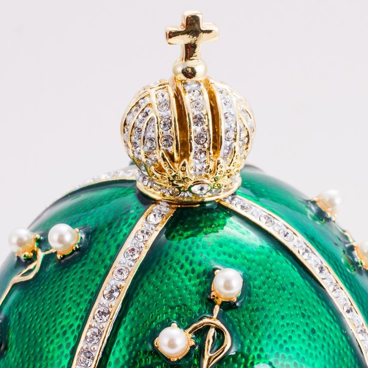 This egg is the copy of a famous Lily of the Valley Faberge Egg , one of the 52 eggs made for the Russian Imperial family.  This egg was made in 1898 and was given by Nicholas II to his wife, Alexandra Feodorovna. The Faberge Egg is known for the wonderful brass flower composition representing lilies of the valley, masterfully accentuated with detailed, sparkling enamel designs. This wondrously beautiful Easter Egg seems to contain the many wonders of the Universe in every molecule of its…