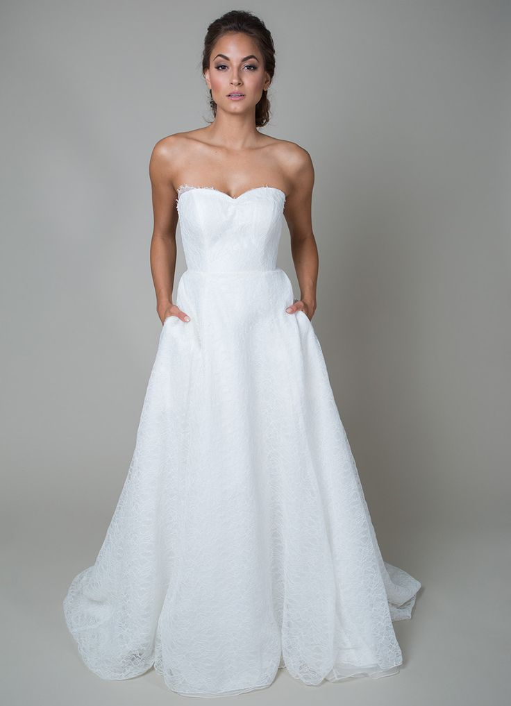 {Eloise Gatsby} Soft and romantic, this A-line wedding dress features a flowing organza skirt, delicate Chantilly lace, a ruched sweetheart neckline, and pockets. Soft, elegant, and classic, this is great for a traditional ceremony!