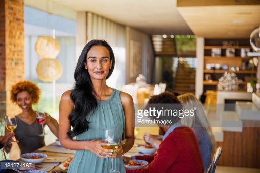 Stock Photo : Woman having guests for dinner.
