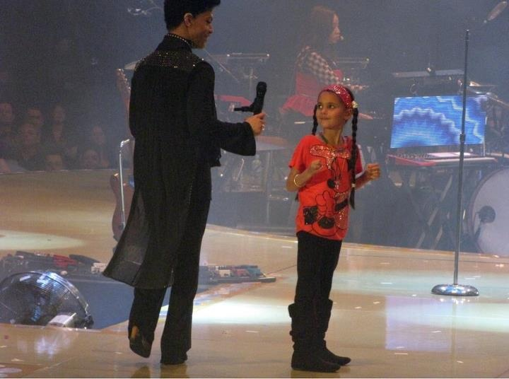 Prince in Australia with a fan.