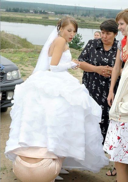How To Relax On Your Wedding Day Bride Gets A Dress Adjustment