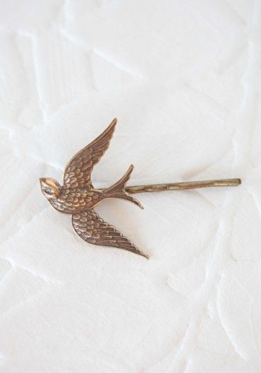 What Would Snow White Wear? A sparrow hairpin to hold back those curls. shopruche.com