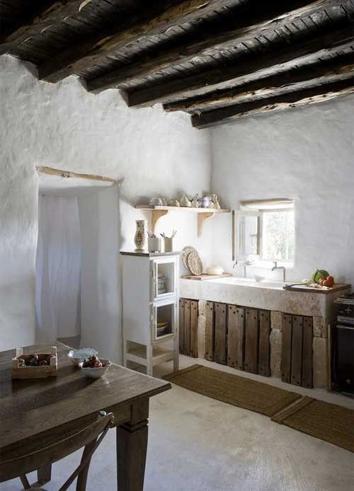 Minimal country kitchen with simple cabinets.