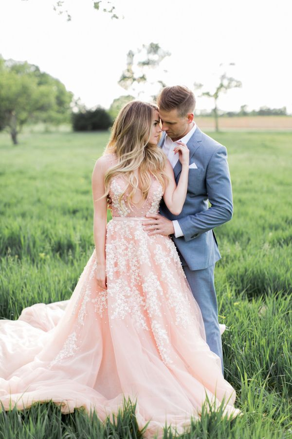 Nikki Ferrel's dreamy pink Marlo Ford gown: http://www.stylemepretty.com/2016/05/10/see-it-here-first-nikki-ferrel-from-the-bachelor-engagement-session/ | Photography: Alea Lovely - http://www.alealovely.com/