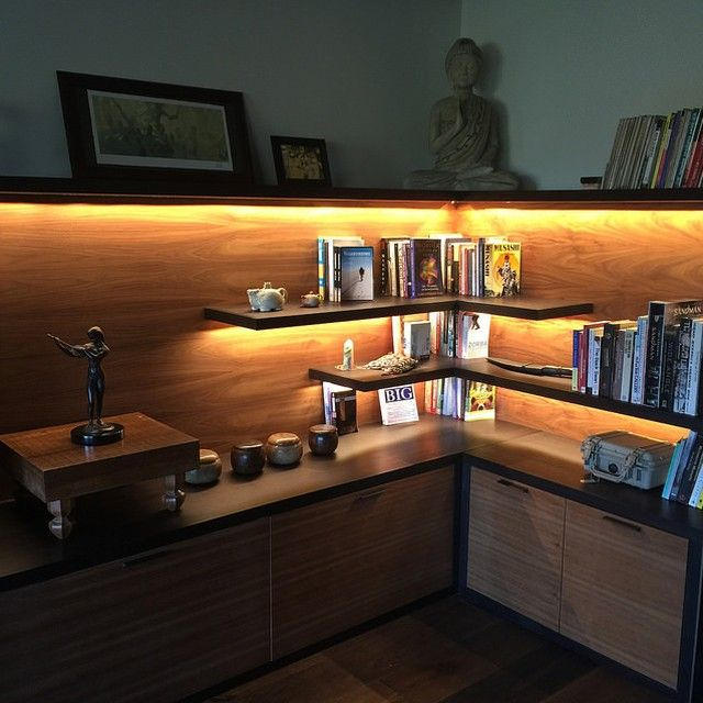 """This is how I organize (and highlight) my """"all-star"""" books in my main living space. All are placed to elicit positive or helpful emotions. Other items include antique go board, Gurkha kukri knife, Pelican box with mystery contents, and Taiwanese stone tea pots..."""