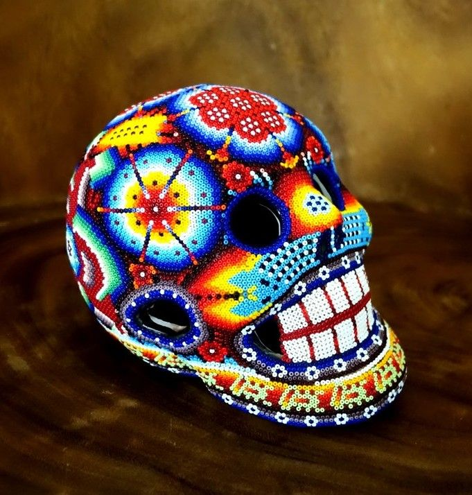 Large Huichol beaded ceramic skull with traditional motifs.  $350 + Free Australia wide shipping, Int Shipping available. http://mexicoconamor.com.au/product-tag/huichol/