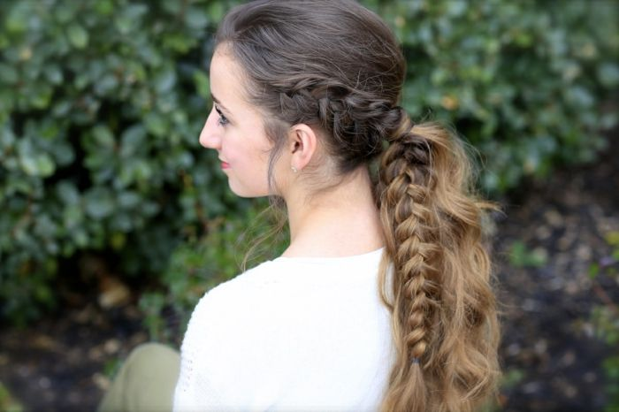 elizabethan hairstyles, smiling young woman, wearing white jumper and red lipstick, with brown and blonde ombre hair, braided in a two-tone-plaid, and tied in a wavy ponytail