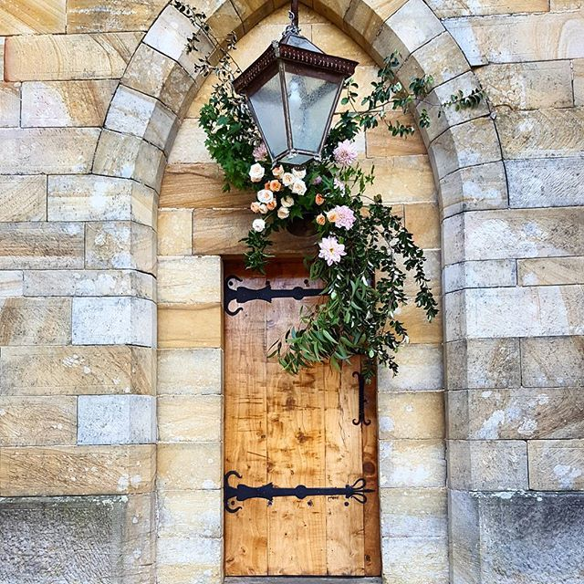 Wedding ceremony floral installation. Attached to a bell above the door of a converted old Church. St Joseph's Guest House, St Albans.