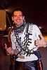 miniature liquor bottles belts costume. burning man 2012. This simple costume will make you immediately very popular. Photo taken at the Burning Man 2012 festival (Black Rock Desert, Nevada). alcohol. barman. burning man festival. night.