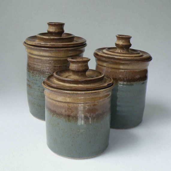 Jazz up your counter space with a set of three handmade ceramic canisters in a great combination of my rustic browns and blue gray. Looks