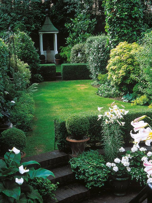 long thin garden rectangles and squares confined within low walls convey a very angular look although the harsh lines are softened by use of delicate - Garden Ideas Long Narrow