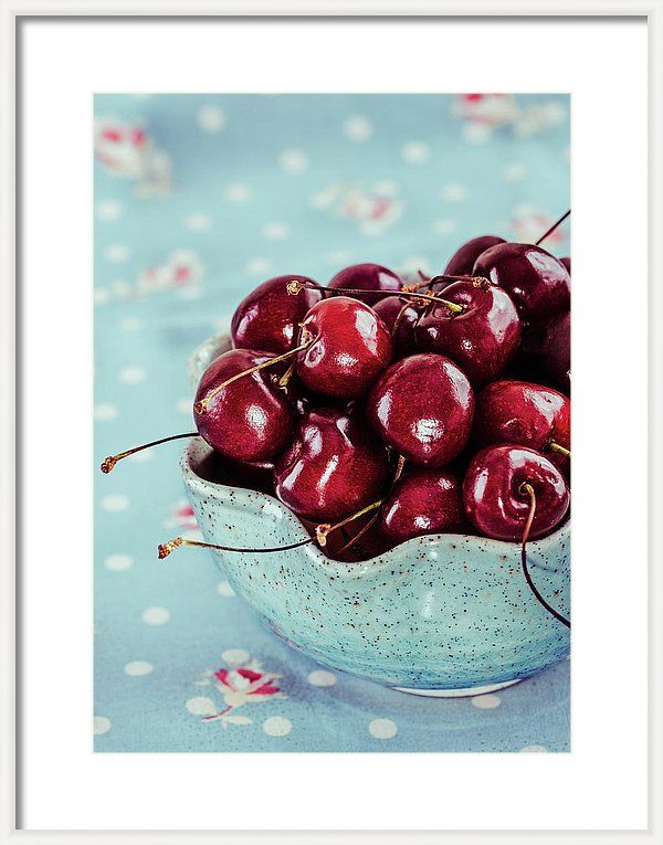 Cherry Framed Print featuring the photograph Red Cherries In Blue Ceramic Bowl by Oksana Ariskina Red cherries in aqua ceramic bowl and fabrics. Available as mugs, posters, greeting cards, phone cases, throw pillows, framed fine art prints, metal, acrylic or canvas prints, shower curtains, duvet covers with my fine art photography online: www.oksana-ariskina.pixels.com #OksanaAriskina