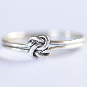Simple stacking, trendy knot ring to pair with other bulkier rings you may have or wear it above your knuckle. Hand made pretty little solid This simple stacking, trendy infinity knot ring will pair w