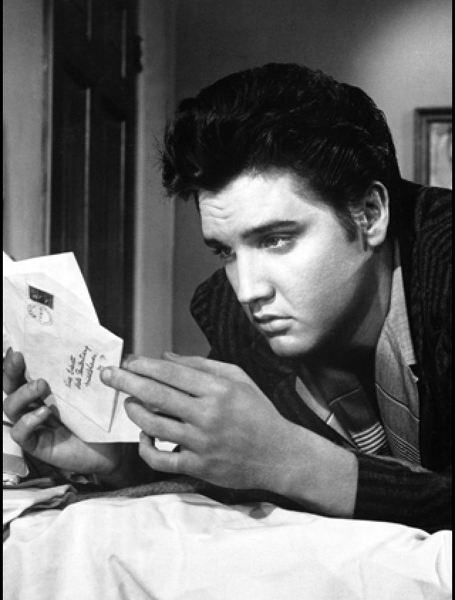 Reading what is probably one of many love letters...let's all think it was a letter from us! Via Elvis Mobile App.
