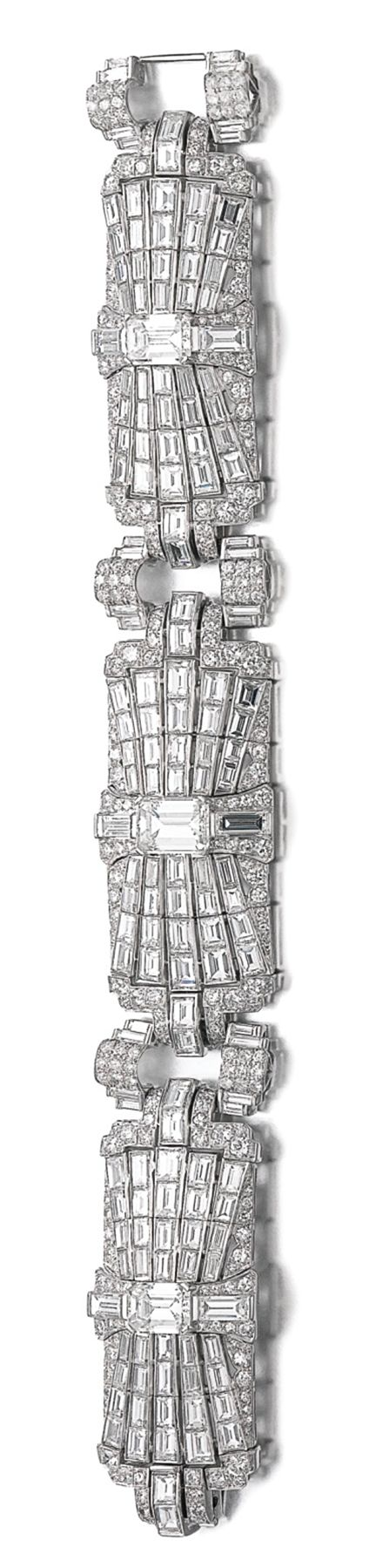DIAMOND BRACELET Composed of a series of pierced plaques of geometric design, set with step-, brilliant-cut and baguette diamonds, length approximately 170mm. Art Deco or Art Deco style.