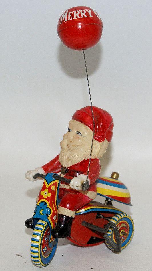 Vintage Suzuki Japan Merry Christmas SANTA CLAUS CYCLE Tin & Celluloid Windup Toy