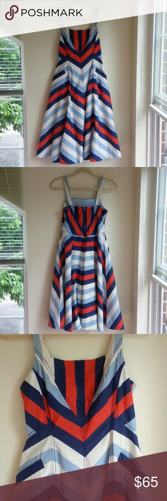 """Anthropologie Red White & Blue Chevron Dress Maeve Stunning retro sundress! Smooth lightweight cotton with a carefully-placed chevron pattern (just check out the bodice!) in navy, powder blue, soft white, and flame/orange-red. Powder blue cotton lining. Nice full skirt, handy pockets, lingerie straps to snap your bra straps into place and keep them hidden, concealed back zip. Dress is in great condition! Ideal for any patriotic event, military homecoming, 4th of July, etc.! Pit to pit 15.5""""…"""