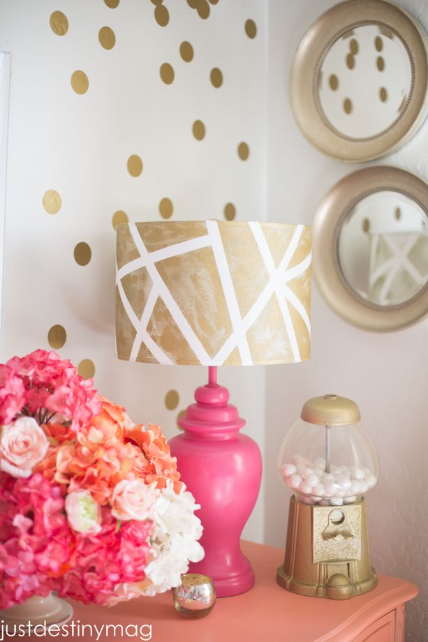 Add bling factor to a plain lampshade using painter's tape & metallic spray paint.