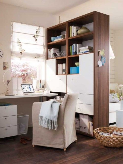 Separated home office in a 20 square meter living room...Cabinet separates a home office & a living room...