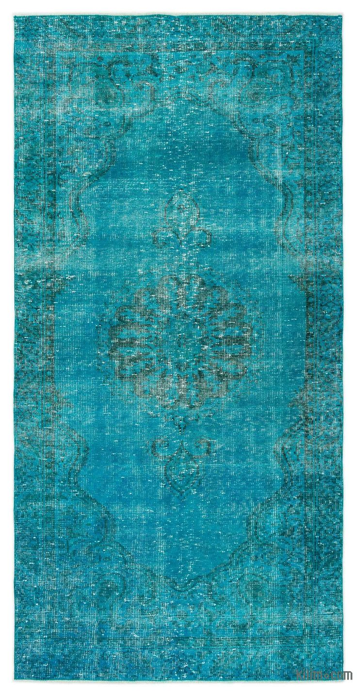 "For a contemporary look with abstract appeal, this turquoise over-dyed rug is skillfully crafted by the revitalization of a hand knotted vintage Turkish rug. Made from wool on cotton, this ""distressed"" rug measures 131 cm x 253 cm. The process in creating these works of art begins by shearing to lower the pile and to help ""distress"" them. They then undergo a series of processes to remove the color. They are now ready to be dyed in one color, a stage that can be repeated several times to rea…"