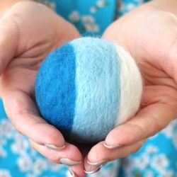 Felted Rattle Ball. Easy project, but time consuming! 2+ hours per felted ball, more if you do an initial or decoration of some sort. Very cute but not practical for tiny fingers that hairs can wrap around or wet mouths. Success for decor, fail for practical toy.