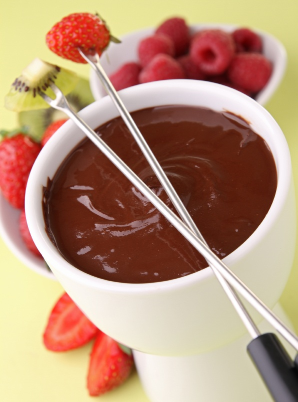 Chocolate Fondue   Box Sunset Gourmet Chocolate Microwave Fudge Mix  ½ cup cold butter ( cubed)  ½ cup milk  Place 1 package Sunset Gourmet Chocolate Microwave Fudge  Mix in a large microwaveable bowl  Add milk and cubed butter, microwave uncovered on high for 2 minutes, stir well, return to microwave and continue to microwave for 1 minute. Stir until smooth.   Place in a dessert fondue pot to keep warm.  Enjoy with assorted fruits, cubed pound cake, marshmallows, or coconut macaroons.