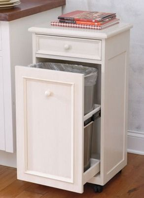 Cute little cabinet with drawer. Also has  pull-out door with bin. Can use in kitchen for garbage/recyclables  or in bathroom for  laundry