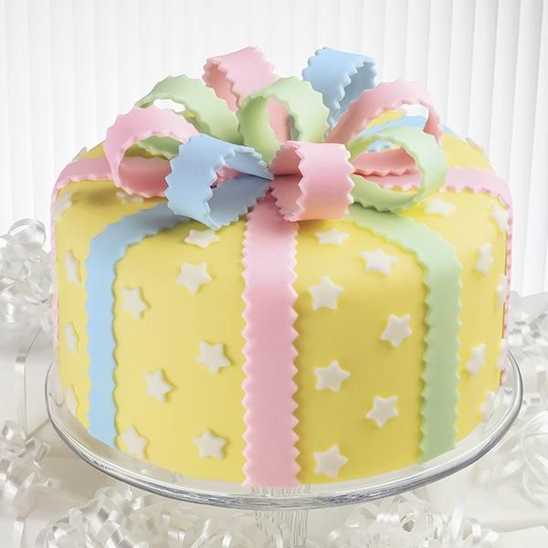 Take a Bow Cake - It's fun to match the cake to the celebration! This cake can be decorated in any color scheme. With a pretty bow on top, this cake is all wrapped up and ready to party in easy-to-use fondant. Watch our online video.