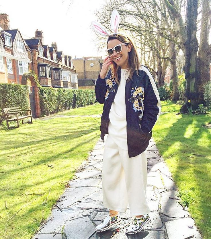bomber jacket with cream top and pants