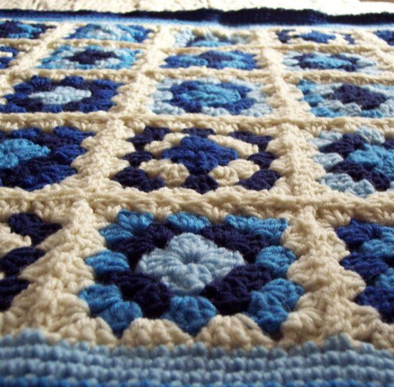 Blueberries and cream heirloom quality blanket for your very special little one. Crocheted with four shades of blue into a creamy white background.