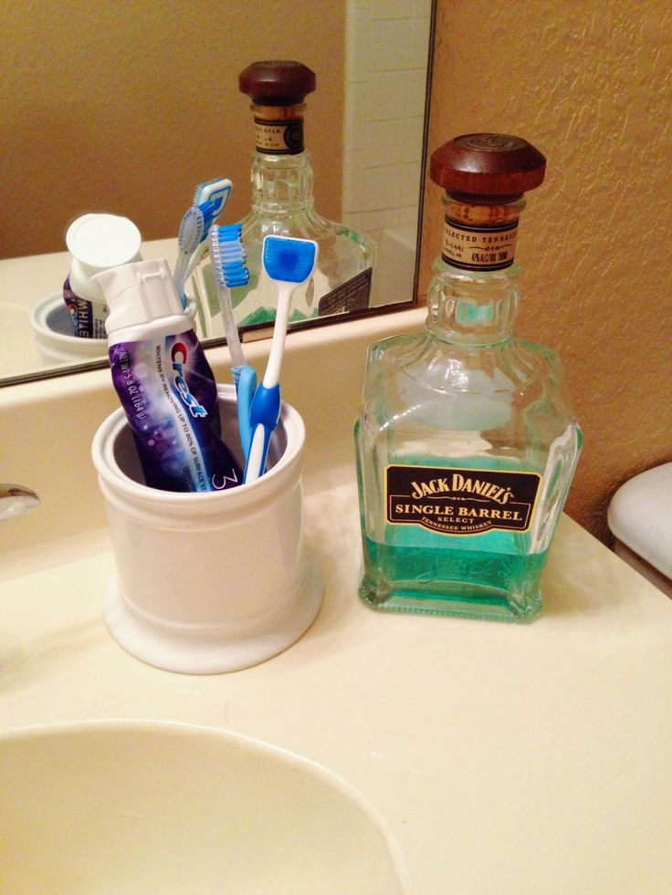 Miranda Writes// Decant mouthwash into an old whiskey bottle for a guy's bathroom//