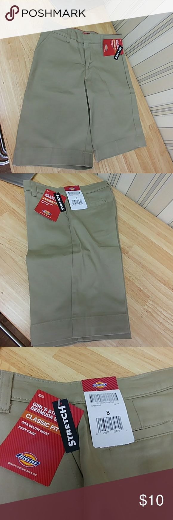 Girls' Classic Fit Bermuda Stretch Twill Short Dickies Girls Stretch Bermunda Shorts, size 8⃣, color beige, sits slightly below the waist, classic fit through seat & thigh, made of 7.3 oz. Twill, 98% Cotton/2% Spandex, long inseam, Stretch fabric, back welt pockets, front  pockets, metal and hook up closure, no exterior logo, compare $18.99 retail price value, comes new with tag as closeout merchandise in good cosmetic condition. Dickies Bottoms Shorts