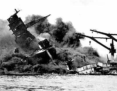 "At 7:55am, Sunday, Dec 7, 1941, Pearl Harbor is attacked by carrier      based Japanese planes, killing 2300. The following day in his war speech to Congress, President Franklin Roosevelt called it ""a day which will live in infamy."""